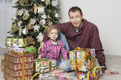 Father gives Christmas gift to his son Royalty Free Stock Images