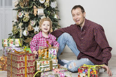 Father gives Christmas gift to his son royalty free stock photography