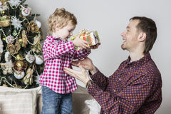 Father gives Christmas gift to his son stock photos