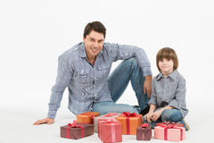 Father gives gifts to his son Royalty Free Stock Photos