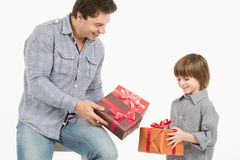 Father gives gifts to his son. Royalty Free Stock Photo