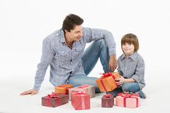 Father gives gifts to his son. Stock Image