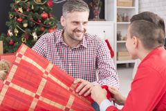 Father gives gifts to son stock image