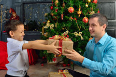The father gives his son a Christmas gift Stock Photo