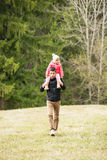 Father gives piggyback to his daughter Royalty Free Stock Images