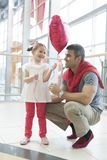 Father gives young daughter heart shaped balloon Stock Photos