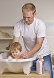Father Giving Daughter Bath Royalty Free Stock Photography