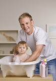 Father Giving Daughter a Bath Stock Photos