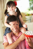 Father Giving Daughter Ride On Shoulders Royalty Free Stock Photography