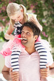 Father Giving Daughter Ride On Shoulders Royalty Free Stock Image