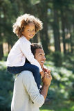 Father Giving Daughter Ride On Shoulders In Countryside Stock Images