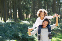 Father Giving Daughter Ride On Shoulders In Countryside. Smiling To Camera Stock Photography