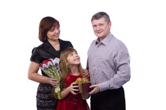 Father is giving gift daughter and mother royalty free stock photos