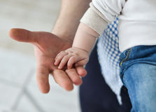 Father giving hand to a child Stock Photos
