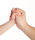 Father giving hand to a child isolated. Over white Stock Photos
