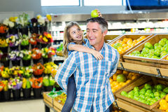 Father giving his daughter a piggy back Stock Images