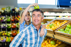Father giving his daughter a piggy back Royalty Free Stock Photo