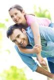 Father giving his daughter a piggyback Royalty Free Stock Photos