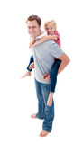Father giving his daughter piggyback ride Royalty Free Stock Photo