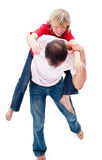 Father giving his son piggyback ride Royalty Free Stock Photo