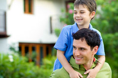 Father giving his son a piggyback ride Stock Images