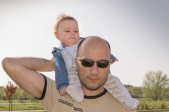 Father giving piggyback ride Royalty Free Stock Photos