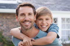 Father giving piggyback ride stock image