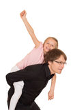 Father giving piggyback ride to his daughter Stock Image