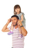 Father giving piggyback to his daughter Stock Photo