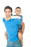 Father giving piggyback to his son Stock Images