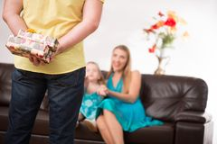 Father giving present to beautiful daughter and Royalty Free Stock Photo