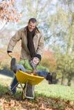 father giving ride son wheelbarrow Στοκ εικόνα με δικαίωμα ελεύθερης χρήσης