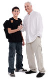 Father giving shakehand to his son. Father giving shake hand to his son on white background Royalty Free Stock Photo