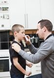 Father giving son Nose Drops Royalty Free Stock Images