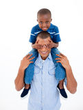 Father giving son piggyback ride Royalty Free Stock Photography