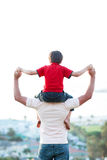 Father giving son piggyback ride. Outdoors Royalty Free Stock Photo