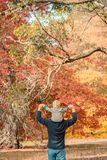 Father giving son piggyback ride. In the autumn park, South Australia Royalty Free Stock Image