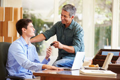 Father Giving Teenage Son Car Keys Stock Photography