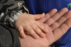 Father, grandfather, holding in my hand the handle of a small child, father`s day.  stock image