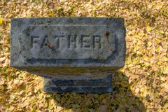 Father Grave Stone. A grave for a father in the fall in Western North Carolina Stock Photography