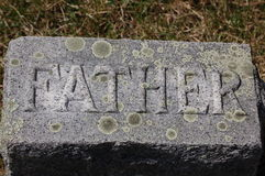 'Father' gravestone. Grave marker at a family grave stock photo