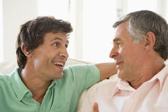 Father and grown up son talking. Together stock photo