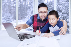 Father guiding his son to learn Royalty Free Stock Photography