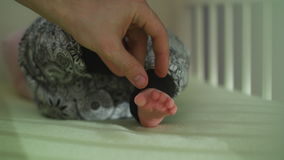 Father Hand Caressing his Baby Feet stock video footage