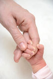 Father hand in hand with baby royalty free stock images