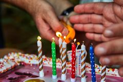 Father hand lights candles  royalty free stock photos