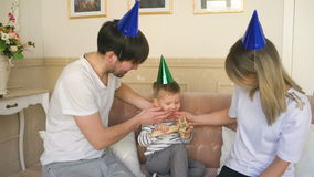 Father of happy family celebrating birthday present gift to his son at home stock video footage