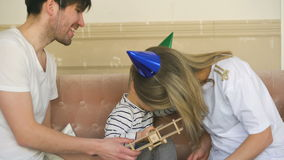 Father of happy family celebrating birthday present gift to his son at home stock video