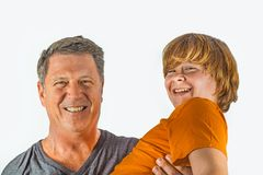 Father and son hugging. Father and happy son hugging stock image