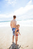 Father and happy young daughter at beach Royalty Free Stock Photo